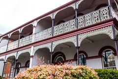 Wrought-iron ornamentation on old terrace houses on Wellington Street