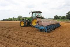 asphalt(0.0), harvest(0.0), crop(0.0), agriculture(1.0), farm(1.0), sowing(1.0), field(1.0), soil(1.0), vehicle(1.0), plough(1.0), agricultural machinery(1.0), harvester(1.0),