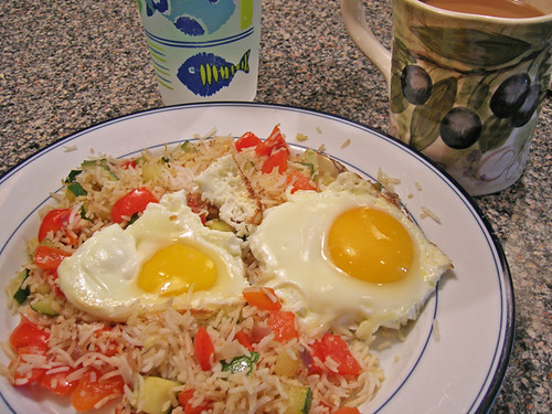 fried eggs with fried zucchini and red bell rice, water, coffee
