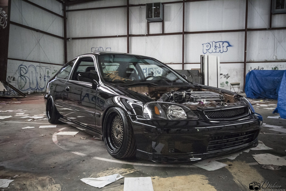 Black turbo Honda civic ek coupe slammed on Klutch wheels Sl1 silver 16x9 with aggressive fitment and stretched tires
