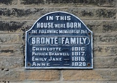 Photo of Charlotte Brontë, Emily Brontë, and Anne Brontë black plaque