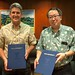 <p>UH Interim President David Lassner and Dr. Yoshiaki Matsumae, Vice President of Tokai University Educational System, renew the agreement for international exchange between the two university systems.</p>