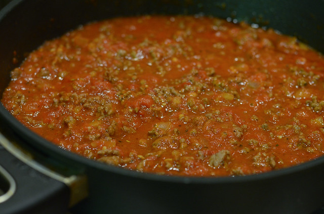 Meat sauce in a skillet on the stove.