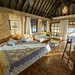 Vahine Island Resort - Overwater Bungalow Bedroom by NOSYTOUR - Diving Tour Operator
