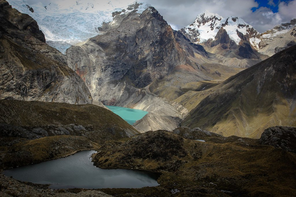 Alpine splendisism. Azure Laguna Jancarurish is fed by the massive glaciers of Alpamayo (5947m) and Quitaraju (6036m), both out of sight. Santa Cruz Grande (6241m) appears at the right. Huascaran National Park. Cordillera Blanca. Peru.
