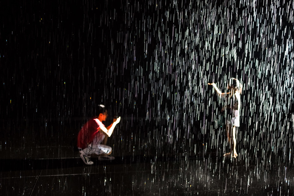 Posing in the MoMA's Rain Room