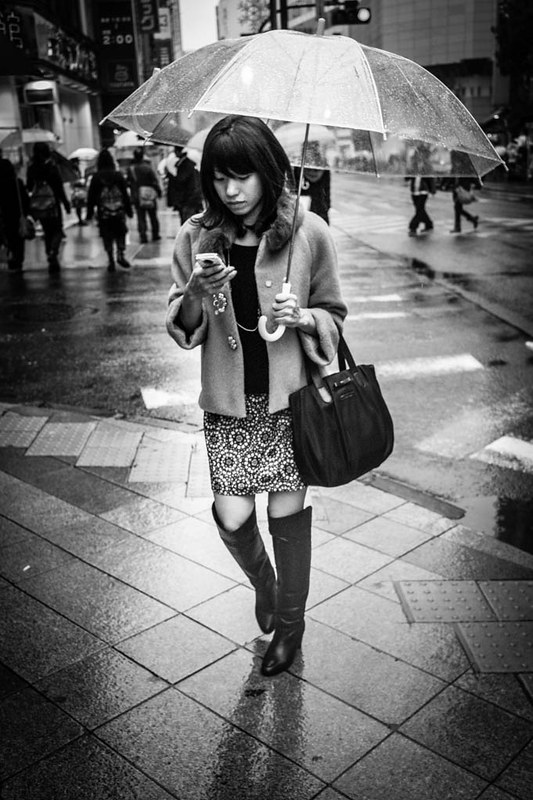 Texting in the rain - Shinjuku.