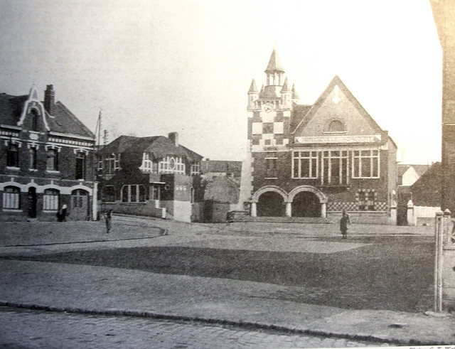 The village square in the 1930s showing the village hall reb