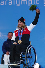 Caleb Brousseau celebrates his bronze medal in the Super-G at the 2014 Paralympic Winter Games in Sochi, RUS