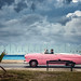 pink car, stormy sky by jody9