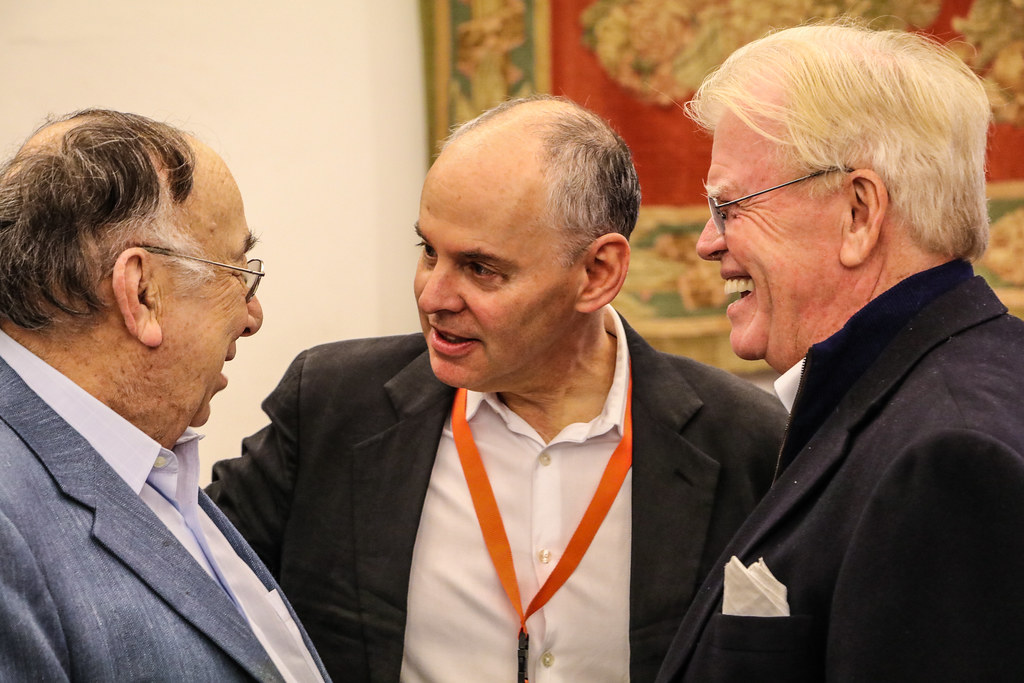 "Bob Appel ('53), Dean Kleinman, and Kevin McGovern '70 catch up after the ""Rome as Ground"" panel.  photo / Bob Joy (B.Arch. '72)"