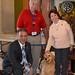 Reps. Camillo and Floren play with a therapy dog during Animal Therapy Awareness Day at the Capitol on Wednesday, April 12, 2017.
