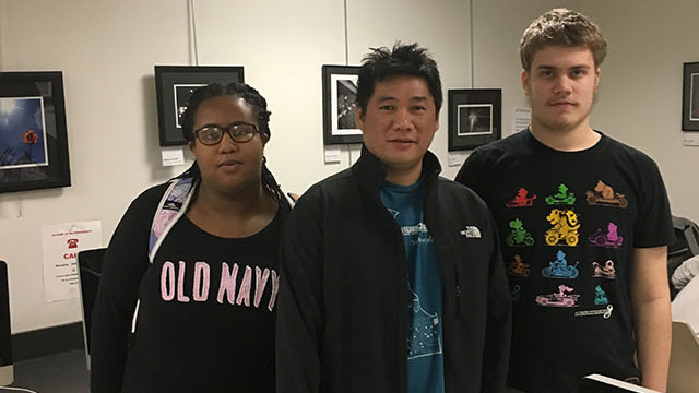 Wilmington University game design and development student Ngu Nguyen (center), with Danielle Alphonse and Erik Wissler, two of the Wallin School students he taught in a recent technology workshop.