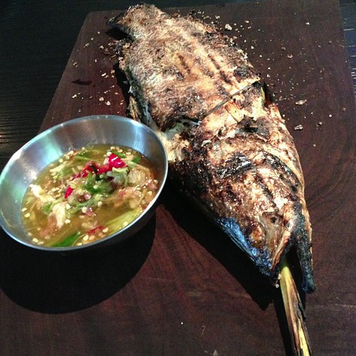 Pla Phao Glua: Salt-crusted whole Seabass stuffed with lemongrass, pandan & Thai basil stalks, slow-cooked over fire & served with a green chili dipping sauce. Kha Singapore.