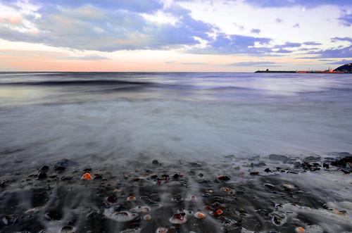 sunset sea sky sun water waterfall focus rocks long exposure stones sunn pwpartlycloudy