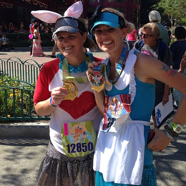 Post race with Alice, I mean ummm @according2kelly today! We survived the awful heat @runDisney #disneylandhalf #teamsparkle #aliceinwonderland #whiterabbit
