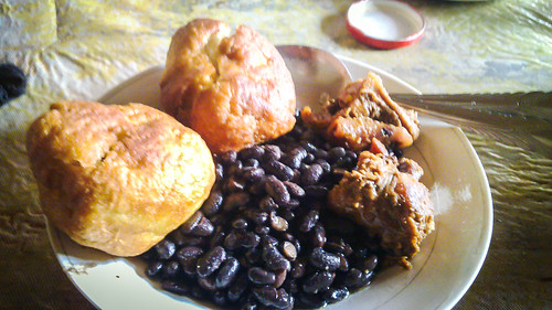 Eating rat with beans and beignets in Cameroon