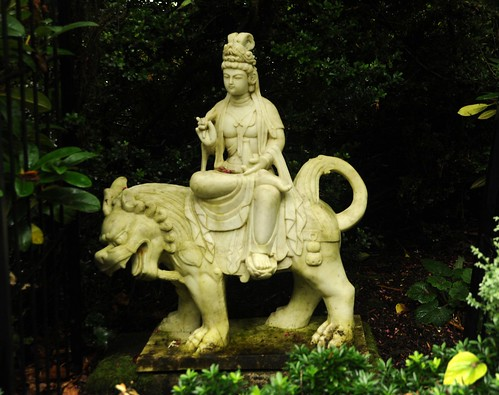 Bodhisattva Manjushri riding a lion,  tall headdress, robes, white carved marble,garden statue, private collection, Llandover by the Sound, Seattle, Washington, USA by Wonderlane