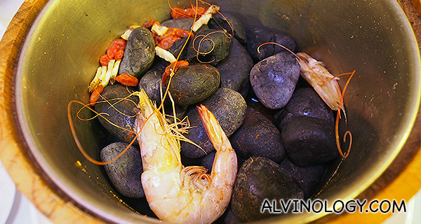 Heated rocks on which the prawns were steamed in a
