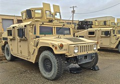 armored car(1.0), automobile(1.0), military vehicle(1.0), sport utility vehicle(1.0), vehicle(1.0), hummer h1(1.0), off-roading(1.0), humvee(1.0), off-road vehicle(1.0), land vehicle(1.0), military(1.0),