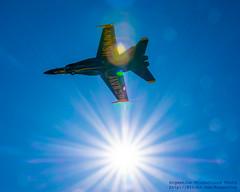 Blue Angels Jet on Approach Under Lens Flare