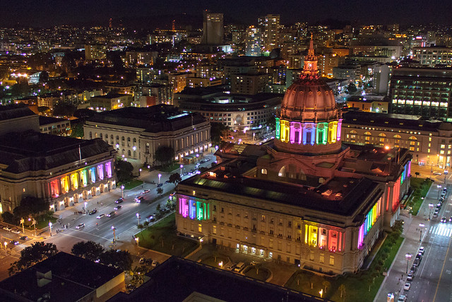 San Francisco City Hall and War Memorial Opera House lit up for SF Pride