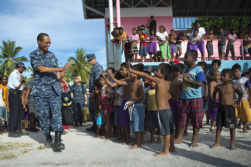 Adm. Cecil D. Haney, commander of U.S. Pacific Fleet, greets children during a visit to Kiribati