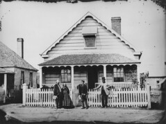 Unidentified family in front of a house on Margaret Street, Brisbane facing east, ca. 1871