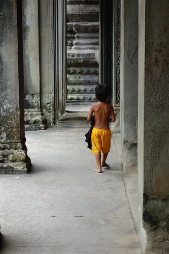 Young kid walking Angkor Wat temple