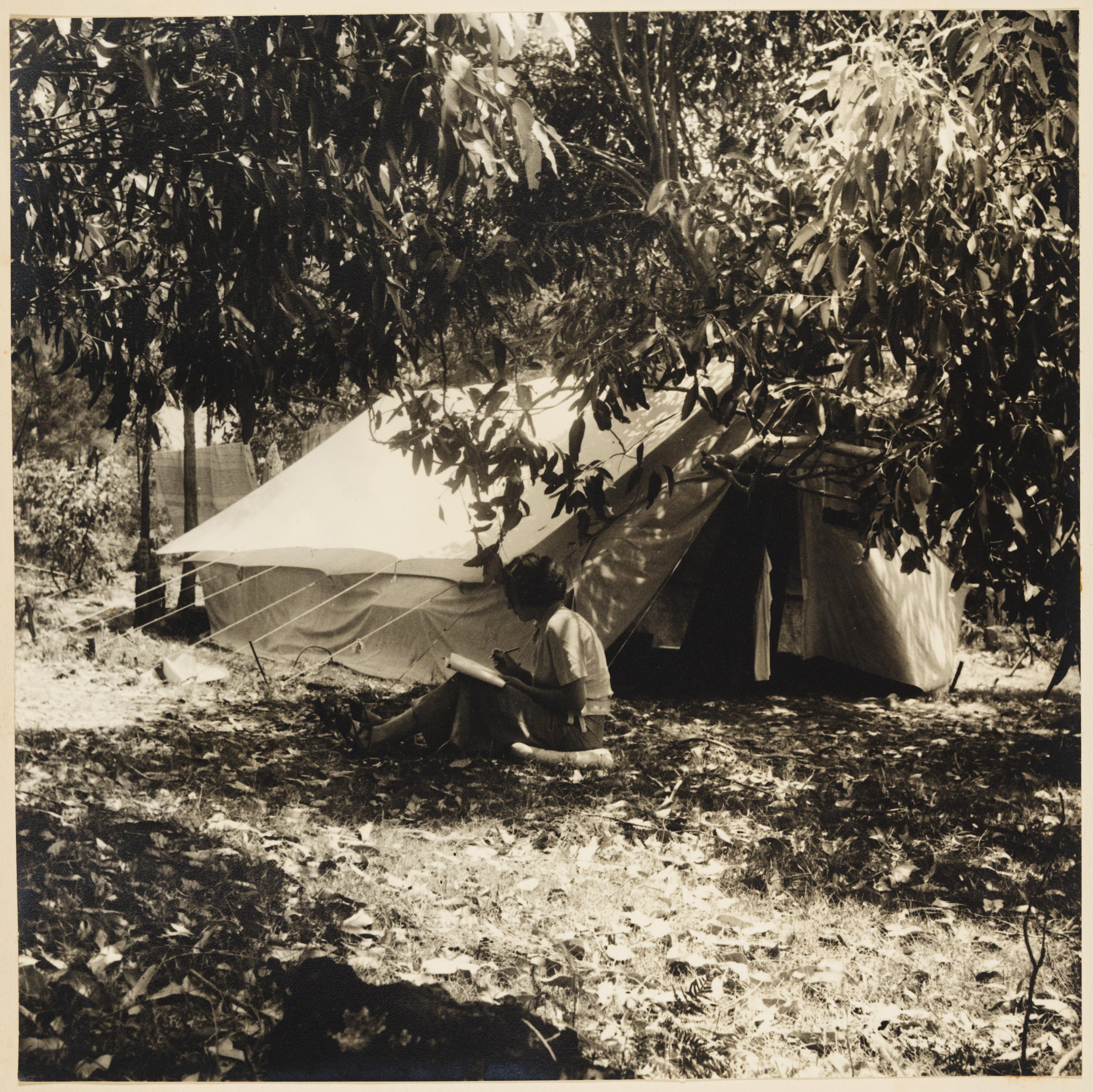 Una Dodd (?) by tent from Camping trips on Culburra Beach by Max Dupain and Olive Cotton