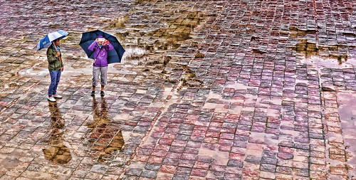 glenniswootton guides holidays hue mangojouneys pavingstones rain topazlabs tourists umbrellas vietnam