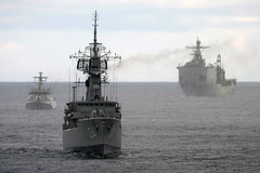 USS Tortuga (LSD 46), right, steams in formation with Indonesian navy ships KRI Oswald Siahaan (CVT 354), left, and KRI Sultan Iskandar Muda (FFG 367), during a live-fire exercise in the Java Sea May 25 as part of CARAT Indonesia. (U.S. Navy photo by Mass Communication Specialist 1st Class Jay C. Pugh)