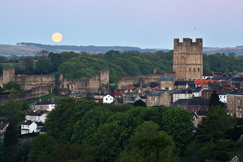 The moon sets behind Richmond Castle, North Yorkshire.