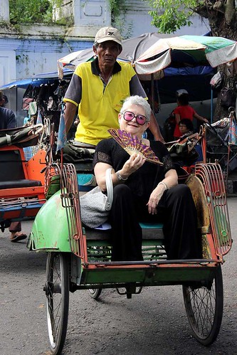 woman in an rickshaw with pink sunglasses