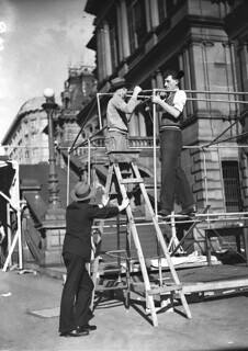 Absent voters at the Town Hall. Erecting polling booth beside Town Hall with galvanised pipe and Downee fittings, 13 Sept. 1934 by Sam Hood