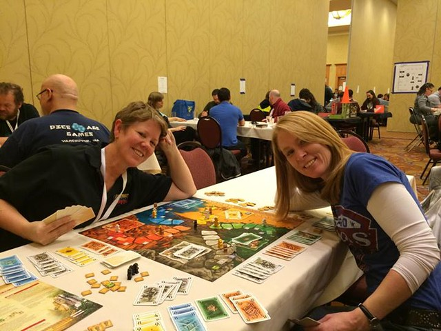 Lost Cities board game with two beautiful ladies