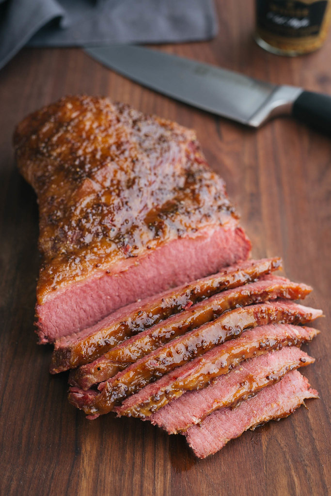 sliced beer braised corned beef with whiskey mustard glaze