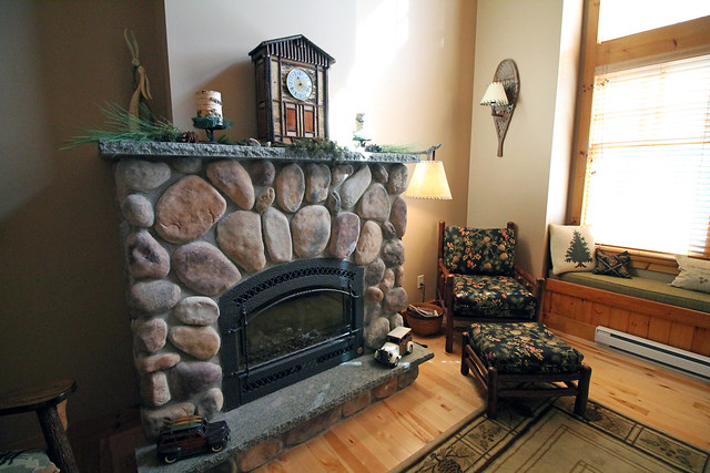 Stone fireplace in great room; Adirondack style furnishings included with a sale;
