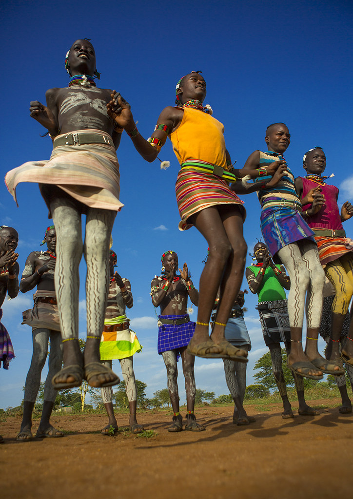 Bashada Tribe Men Dancing And Jumping, Dimeka, Omo Valley, Ethiopia