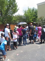 The 100 plus temps didn't prevent these folks from taking advantage of the free food smoked onsite