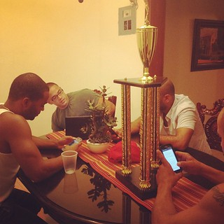 This is what we do we use our cellphones we haven't use in days. With our barrow Wifi from the neighbor. While our basketball championship trophy sit in the middle of the table. Dominican Modern Style.