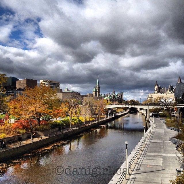 Postcard pretty Ottawa with the Rideau Canal, Parliament Buildings and Chateau Laurier.