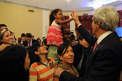 Secretary Kerry Greets a Family Member of Embassy Manila Staff