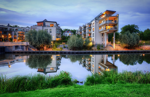 city trees houses windows lake water grass night clouds stairs reflections bench concrete cloudy sweden stockholm dusk lock steps balconies sverige lamps bouy pillars railings hdr sickla sluss sicklakanal
