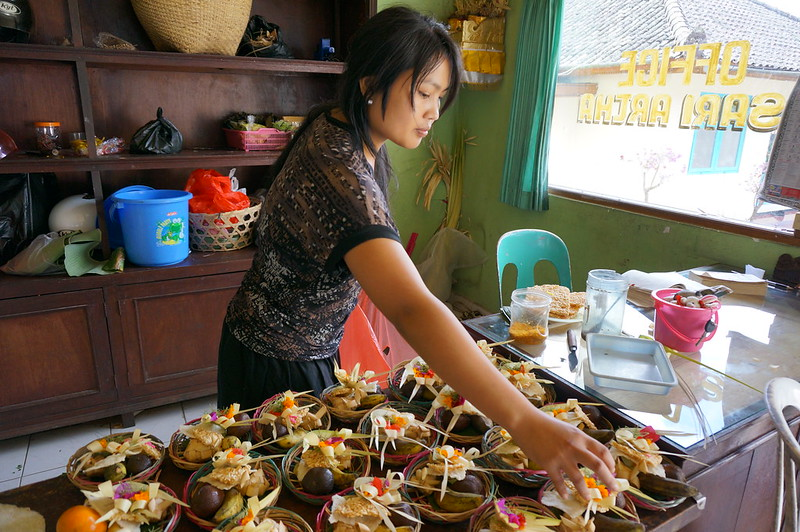 Lady owning hotel in Bedugul preparing offerings for Gods.