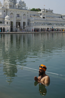 Sikh man praying in holly bath in Golden Temple, Amritsar, North India