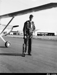 1954. Pilot J.F. Wear with survival gear pack worn on leg during aerial surveys. Hillsboro Airport, OR.