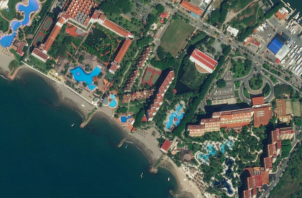 A beach with resorts