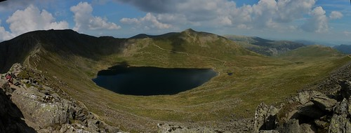 View over Red Tarn to the summit of Helvellyn with Striding Edge and Swirrel Edge flanking either side