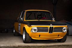race car, auto racing, automobile, vehicle, automotive design, bmw new class, antique car, sedan, land vehicle, coupã©, sports car,